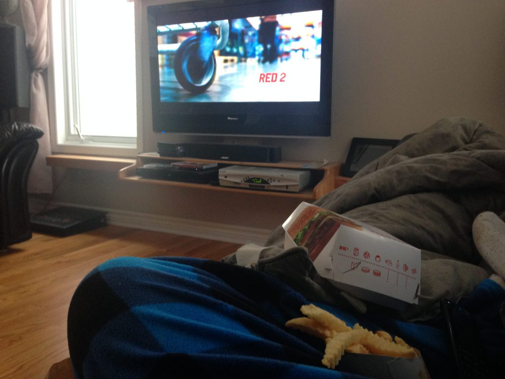 Pictured: Today's lunch, a crappy movie (Red 2), and my adult-sized, ultra-comfortable onesie.